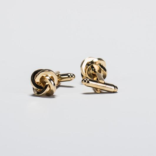 Manschettknappar knut i guld