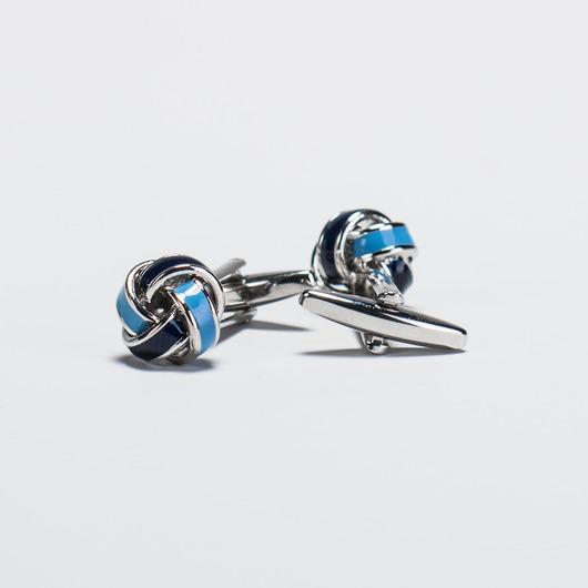 Knotenförmige Manschettenknöpfe mit silbernen Details